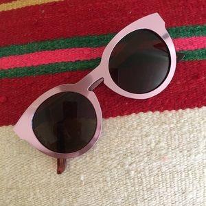 Pink metal cat eye sunglasses.